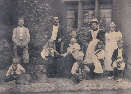 Sutton family photo outside their home in Dorking